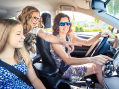 family using car stereo for car safety