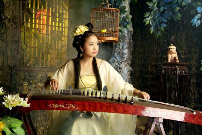 woman playing koto