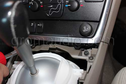 Remove the two screws on the bottom  of the center console