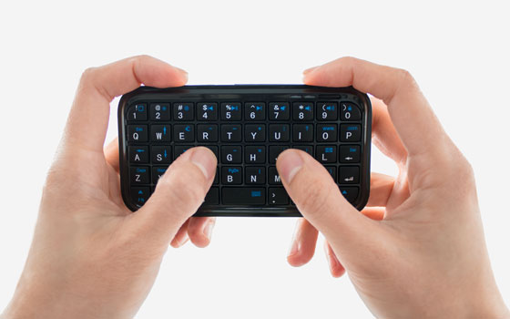Mini Bluetooth Keyboard in hands